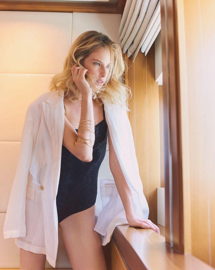 Chanel swimsuit; Salvatore Ferragamo jacket; Tiffany & Co. bracelets.